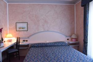 Letto o letti in una camera di Hotel Grazia Deledda