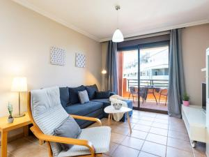A seating area at Apartment Sunny Tejita