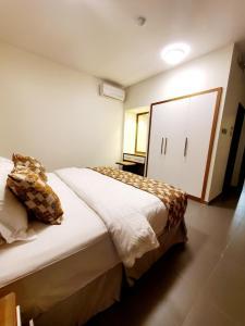 Cama ou camas em um quarto em باشن للفلل الفندقية