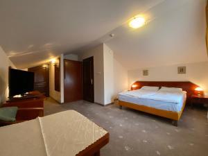 Łóżko lub łóżka w pokoju w obiekcie Hotel Grant