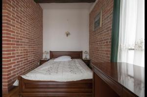 Łóżko lub łóżka w pokoju w obiekcie Hotel Restauracja Pod Parowozem