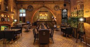 Restauracja lub miejsce do jedzenia w obiekcie Apartamenty Luizjana