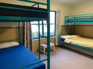 A bunk bed or bunk beds in a room at Camp Elim