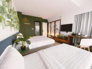 A bed or beds in a room at The Atelier Boutique Hotel