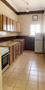 A cozinha ou cozinha compacta de Marina Suites