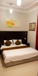 Cama ou camas em um quarto em Marina Suites