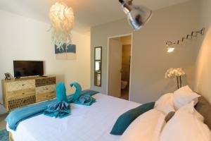 Un ou plusieurs lits dans un hébergement de l'établissement Villa Turquoise