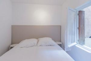A bed or beds in a room at Modern apt near VIEUX PORT - Marseille
