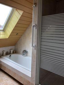 A bathroom at La Casa aan Zee
