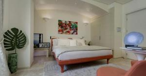A bed or beds in a room at Hotel Villa Blu Capri