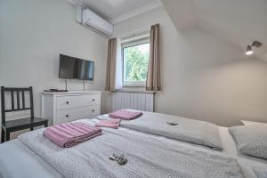 A bed or beds in a room at Villa Harmonia