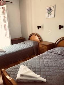Ένα ή περισσότερα κρεβάτια σε δωμάτιο στο Terra Mare Hotel