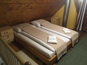 Postelja oz. postelje v sobi nastanitve Pastirski stan