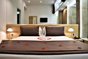 Cama ou camas em um quarto em Hotel Paolo II