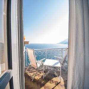 A balcony or terrace at Hotel Club Due Torri
