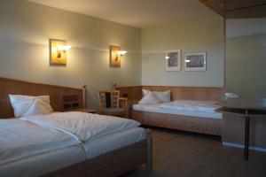 Ein Bett oder Betten in einem Zimmer der Unterkunft Landhaus Bisping