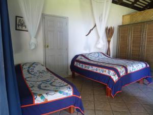 Cama ou camas em um quarto em Hôtel Atiapiti