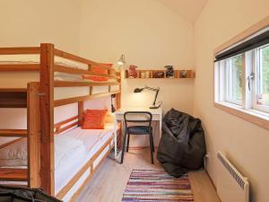 Ein Etagenbett oder Etagenbetten in einem Zimmer der Unterkunft Holiday home Nykøbing Sj XXIV