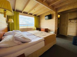 A bed or beds in a room at Baikal View Hotel