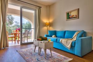 A seating area at Paxos Club Resort & SPA