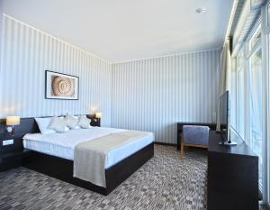 Кровать или кровати в номере Апарт-Отель «Бристоль»