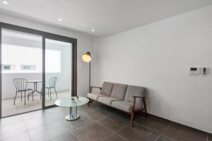 A seating area at Modern 1br w AC & terrace in the heart of Joliette in Marseille Welkeys