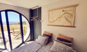 A bed or beds in a room at Aktion Ericeira Surf Hostel