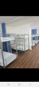 A bunk bed or bunk beds in a room at Albergue Turístico La Peregrina