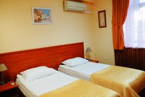 Кровать или кровати в номере Гостиница Лефортовский Мост