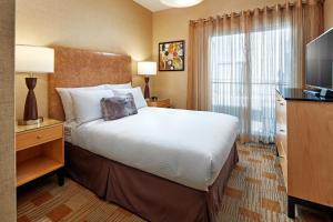 Un ou plusieurs lits dans un hébergement de l'établissement Elan Hotel