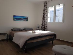 Un ou plusieurs lits dans un hébergement de l'établissement La Belle Créole