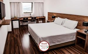 A bed or beds in a room at Trade Hotel