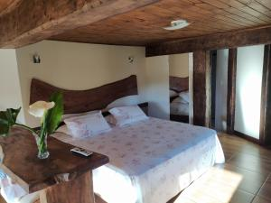 A bed or beds in a room at Brisa de Lavras