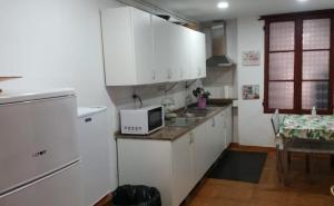 Una cocina o zona de cocina en Obradoiro