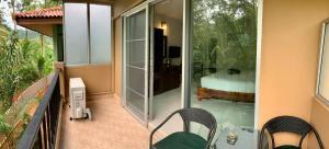 A balcony or terrace at Sri Chada Hotel