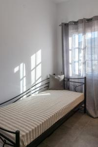 A bed or beds in a room at Aristeides - Moscha Apartments