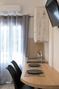 A kitchen or kitchenette at Aristeides - Moscha Apartments