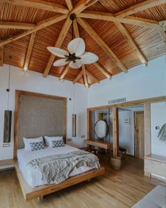 A bed or beds in a room at Stella Island Luxury Resort & Spa (Adults Only)