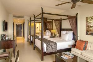 A bed or beds in a room at Secrets Wild Orchid