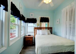 A bed or beds in a room at Biarritz Motel & Suites