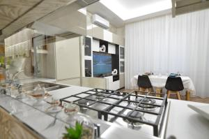 A restaurant or other place to eat at CASERTA DELUXE BIS