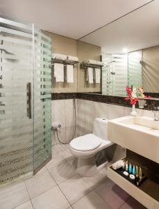 Um banheiro em Le Park Concord Hotel - Turaif