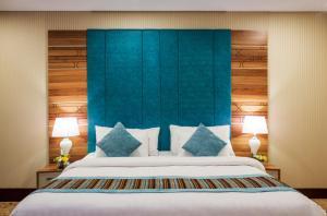 Cama ou camas em um quarto em Le Park Concord Hotel - Turaif