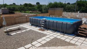 The swimming pool at or near I Trulli Di Nonno Giovanni
