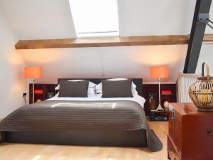 A bed or beds in a room at The Studio