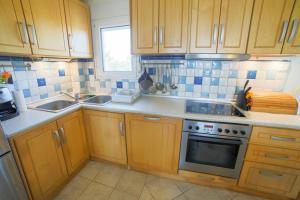 A kitchen or kitchenette at Sea Side Maisonette