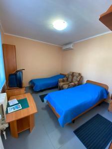 A bed or beds in a room at Гостевой дом Домашний на Черноморской
