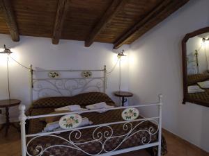Letto o letti in una camera di B&B Villa San Marco
