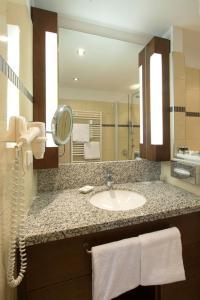 Ein Badezimmer in der Unterkunft Seehotel Rust