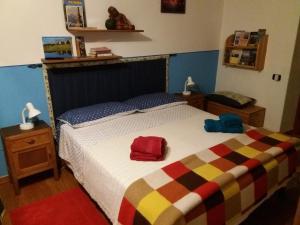 Letto o letti in una camera di B&B IL CASTELLO Lago Maggiore